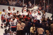 Swedish ice hockey player Stefan Persson of the New York Islanders celebrates his team's fourth consecutive Stanley Cup victory by raising the cup...