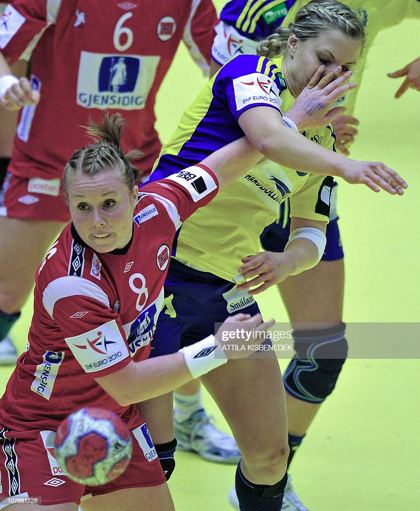 Swedish Isabelle Gullden (R) is pushed by Norwegian Karoline Breivang (L) during the 9th Women's Handball European Championships final on December 19, 2010, in MCH Arena of Herning. Norway won the gold medal by 25-20.