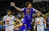 Swedish Jonas Kallman of Hungarian MOLPick Szeged shoots the ball between Alem Toskic and Sergei Gorbok of Macedonian HC Vardar in Szeged on February...