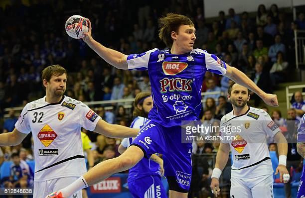 Swedish Jonas Kallman of Hungarian MOLPick Szeged shoots the ball between Alem Toskic and Sergei Gorbok of Macedonian HC Vardar in Szeged on February...