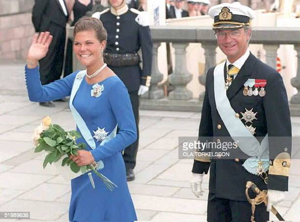 Swedish King Carl Gustav looks on as his daughter crownprincess Victoria flashes a smile towards waiting photographers 14 July prior to a birthday...