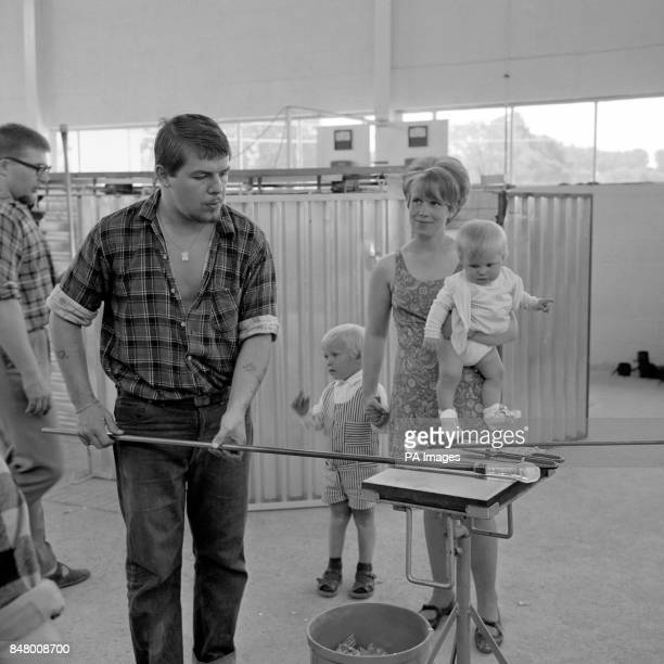 Swedish master blower Taivo Legeiberg is watched by his family as he secures the stem of a glass at the newly opened factory of Dartington Glass Ltd...
