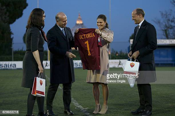 Swedish Minister of Education Anna Ekstrom and Princess Victoria of Sweden receive a AS Roma football shirt from AS Roma General Manager Mauro...