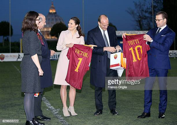 Swedish Minister of Education Anna Ekstrom Princess Victoria of Sweden and Prince Daniel of Sweden receive a AS Roma football shirt from AS Roma...