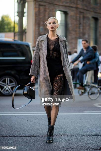 Swedish model Elsa Hosk wearikg a black sheer dress grey checked coat is seen outside Alberta Ferretti during Milan Fashion Week Spring/Summer 2018...