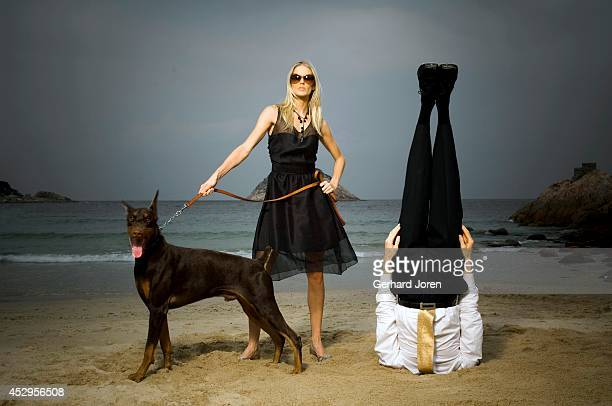 Swedish model Sofia Wallin poses with a dog and Alexander Medin a Norwegian yoga teacher He performs a yoga pose controling his breath for 5 minutes...
