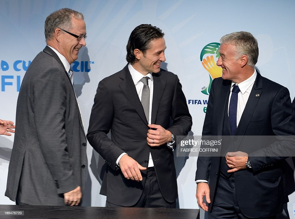 Swedish national football team coach Erik Hamren, Croatian national football team coach Niko Kovac and French national football team coach Didier Deschamps smile after the draw of the 2014 FIFA World Cup European zone play-off matches at the headquarters of the football's world governing body on October 21, 2013. The play-off matches are due to be played on November 15 and 19 respectively.