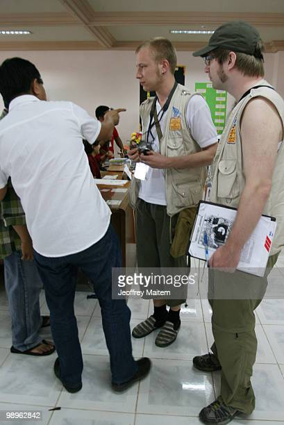 Swedish national Lennart Niemela and Finnish Mikko Sauli foreign monitors belonging to People's International Observers' Mission are seen talking to...