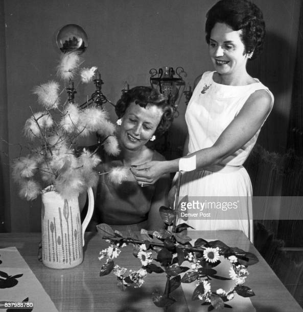 Swedish Party Decor Mrs Robert Harrington and Mrs William Goodin put the final touches on a Swedish Easter tree trimmed with blue pink and yellow...
