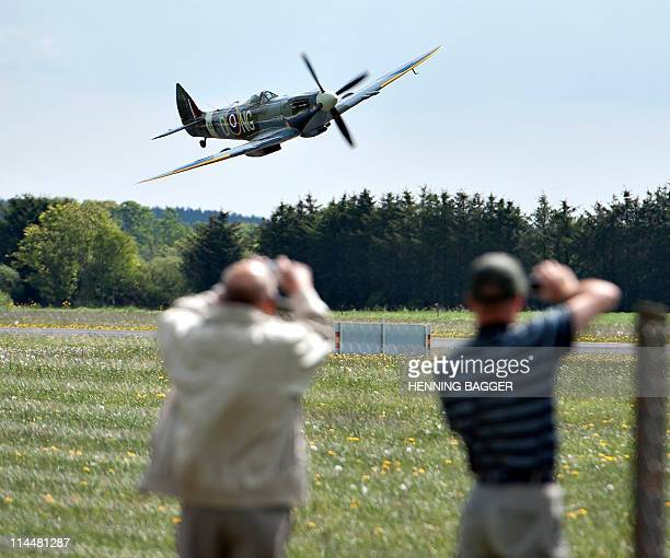 Swedish pilot Paer Cederqvist flies low along Sindal Airport in northern Jutland in a British WWII Spitfire fighter plane on May 21 on his way to...