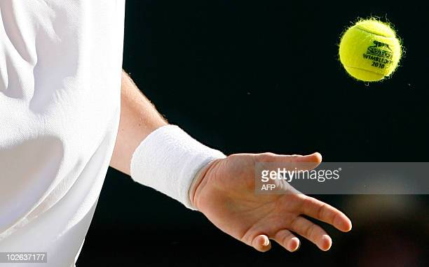Swedish player Robin Soderling catches a ball during play against US player Robby Ginepri during the Wimbledon Tennis Championships at the All...