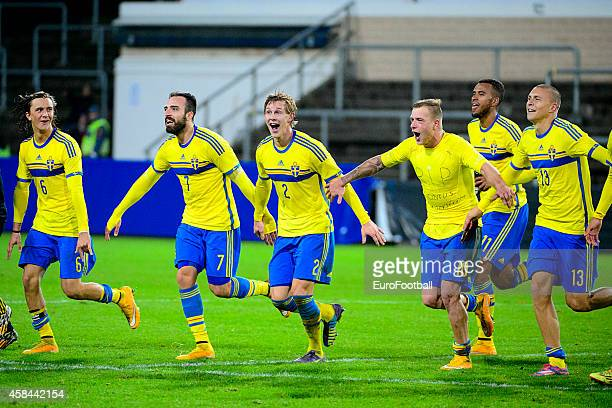 Swedish players celebrate after winning the UEFA Under21 Championship qualifying match between Sweden and France in Orjans Vall Stadium on October 14...