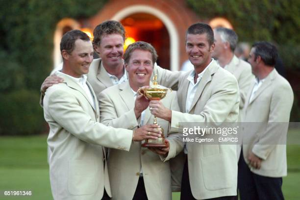 Swedish players Niclas Fasth Pierre Fulke Jesper Parnevik and Assistant Joakim Haeggman celebrate with the Ryder Cup Trophy