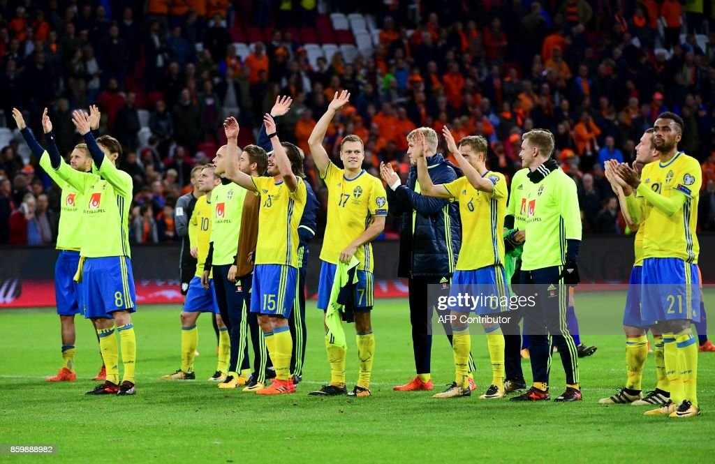 Swedish players react at the end of the FIFA World Cup 2018 football, Group A, qualification match between the Netherlands and Sweden at the Amsterdam Arena in Amsterdam on October 10, 2017. /