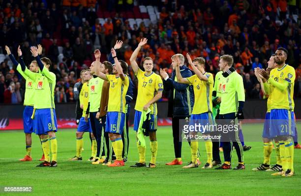 Swedish players react at the end of the FIFA World Cup 2018 football Group A qualification match between the Netherlands and Sweden at the Amsterdam...