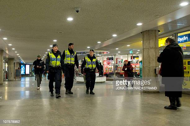Swedish police officers patrol at a subway station in Stockholm on December 14 2010 The farright Sweden Democrats demanded today a debate in...
