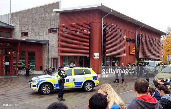 Swedish police officers secure the area outside a primary and middle school in Trollhattan southwestern Sweden on October 22 where a masked man armed...