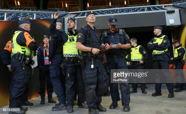 Swedish policeman patrol around the Friends Arena on May 23 2017 in Stockholm Sweden