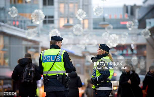 Swedish policemen patrol on December 13 2010 near the Drottninggatan shopping street in Central Stockholm where an apparent car bomb and a separate...