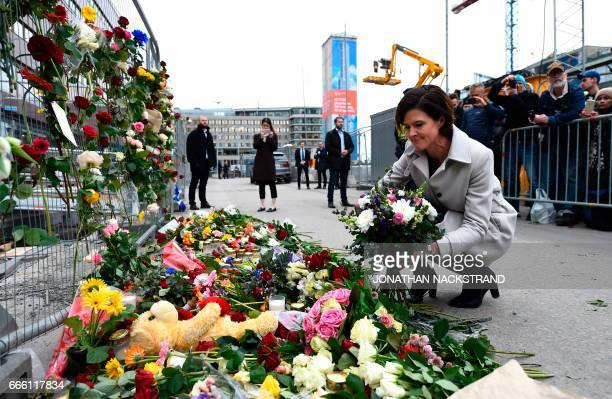 Swedish politician of Moderate party Anna Kinberg Batra lays flowers at a makeshift memorial near the site where a truck slammed into a crowd...