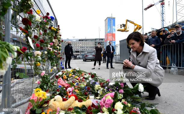 Swedish politician of Moderate party Anna Kinberg Batra pays respect at a makeshift memorial near the site where a truck slammed into a crowd...