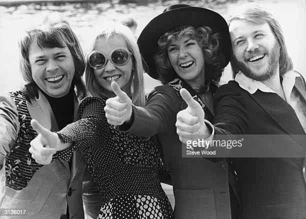 Swedish pop group ABBA give the thumbs up after winning the Eurovision Song Contest with their song 'Waterloo' Brighton 7th April 1974 Left to right...