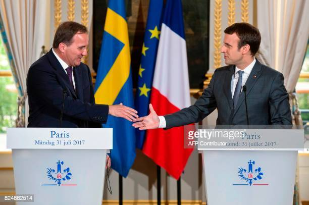 Swedish Prime Minister Stefan Lofven and French President Emmanuel Macron shake hands during a joint press conference after their meeting at the...