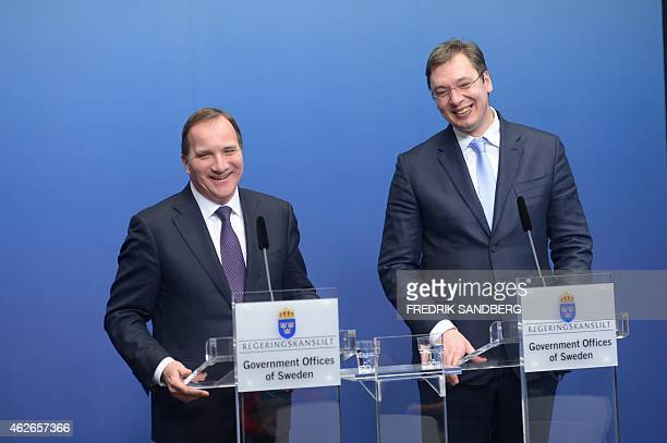 Swedish Prime Minister Stefan Lofven and Serbian counterpart Aleksandar Vucic smile during a press conference after bilateral talks at the government...