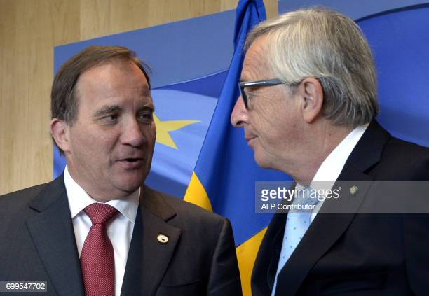 Swedish Prime Minister Stefan Lofven is welcomed by European Union Commission President JeanClaude Juncker prior to a meeting at the European Union...