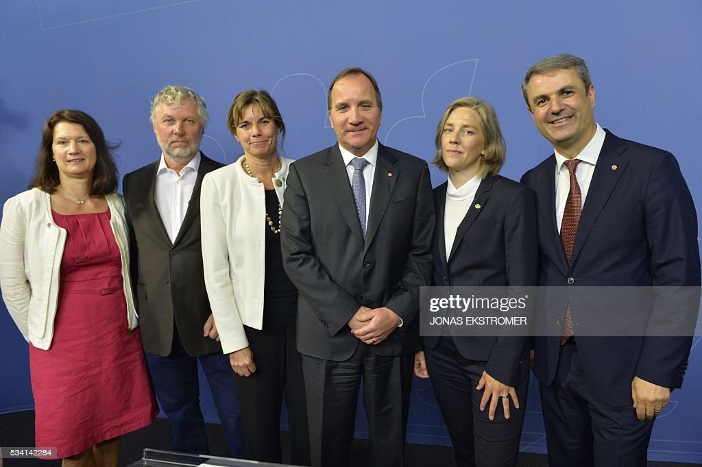 Swedish Prime Minister Stefan Lofven (C) poses with new cabinet ministers Ann Linde (L), EU and trade; Peter Eriksson (2nd L), housing and digitizing; Isabella Lovin (3rd L), international development and climate; Karolina Skog (2nd R), environment and Ibrahim Baylan (R), coordination and energy, at a press conference after a government reshuffle on May 25, 2016. / AFP / TT News Agency / Jonas EKSTROMER / Sweden OUT