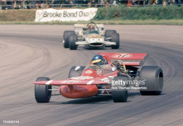 Swedish racing driver Ronnie Peterson drives the STP March Racing Team March 711 Cosworth V8 ahead of British racing driver David Prophet in the...