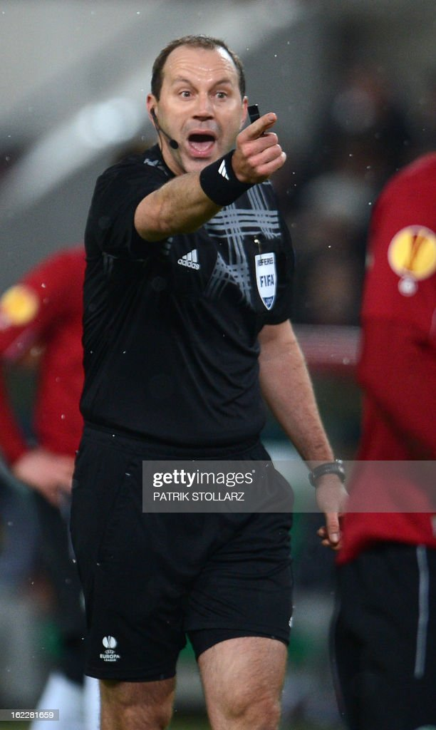 Swedish referee Jonas Eriksson reacts during the UEFA Europa League Round of 32 football match Hannover 96 vs FC Anzhi Makhachkala in Hanover, northern Germany on February 21, 2013.
