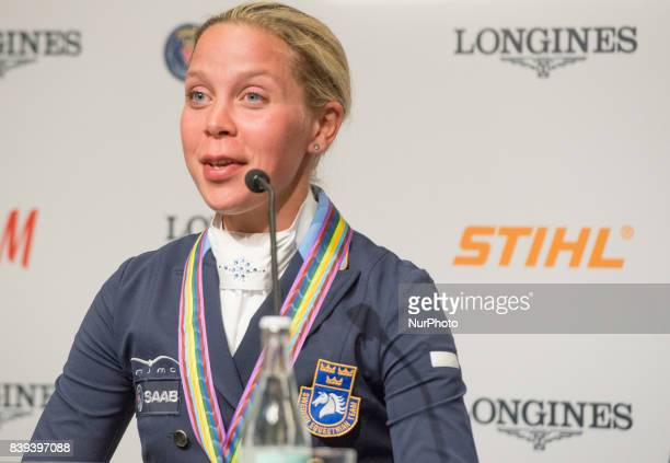 Swedish rider Therese Nilshagen meets the press after winning the bronze medal in the team dressage competition of the 2017 FEI European...