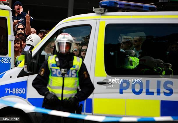 Swedish riot police block leftist activists during an antiIslam demonstration in Stockholm on August 4 2012 Violence erupted during the demonstration...