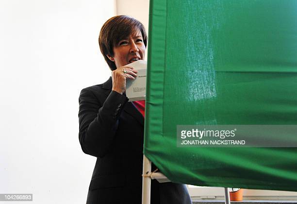 Swedish Social Democrats party leader Mona Sahlin licks the envelop of her ballot as she votes in the Stockholm suburb of Nacka on September 19 2010...
