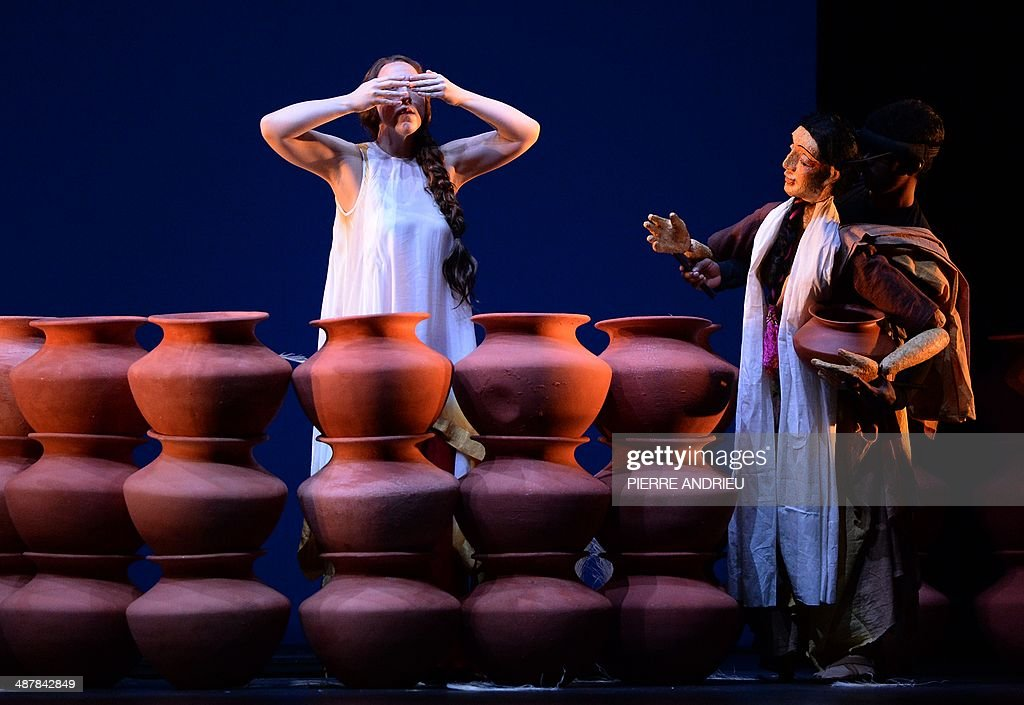 Swedish soprano Paulina Pfeiffer (L) performs along with a puppeteer during a full dress rehearsal of the Opera 'A Flowering Tree' at the Chatelet theater on May 2, 2014 in Paris. The Opera by composer John Adams and staged by Indian director and screenwriter Vishal Bhardwaj, is inspired by a southern Indian folk tale describing the trials and tribulations of a young couple to demonstrate the power of love. It shows through May 5 - 13, 2014 at the Chatelet theater in Paris.
