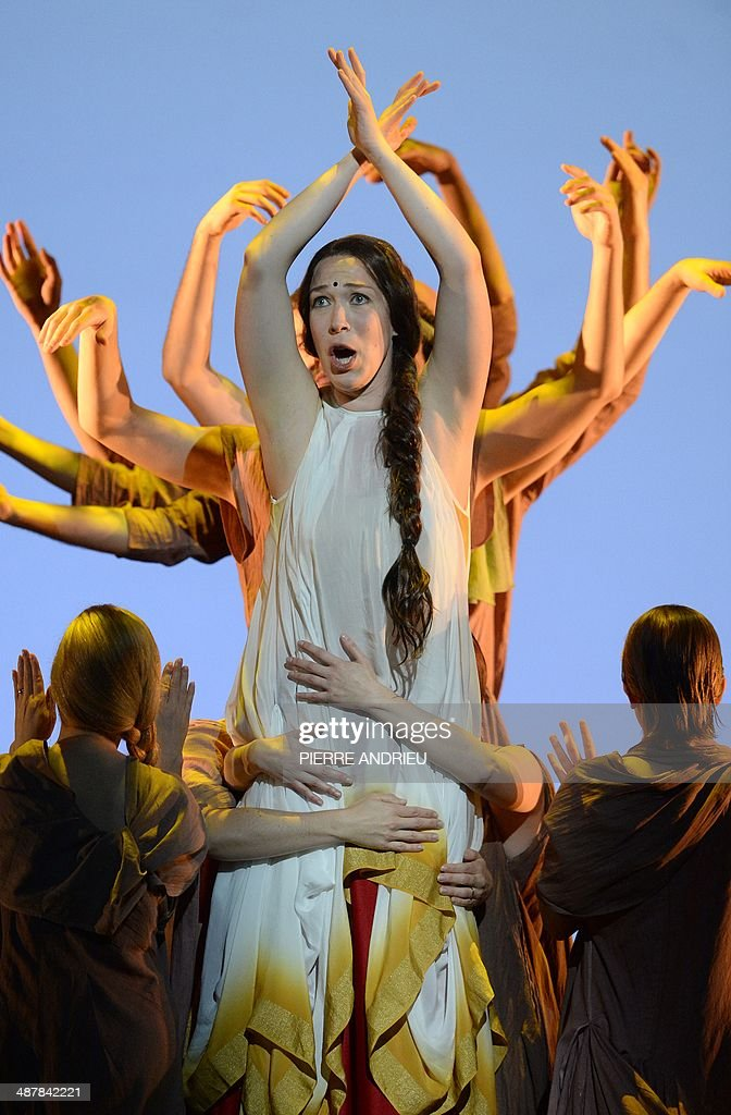 Swedish soprano Paulina Pfeiffer (C) performs during a full dress rehearsal of the Opera 'A Flowering Tree' at the Chatelet theater on May 2, 2014 in Paris. The Opera by composer John Adams and staged by Indian director and screenwriter Vishal Bhardwaj, is inspired by a southern Indian folk tale describing the trials and tribulations of a young couple to demonstrate the power of love. It shows through May 5 - 13, 2014 at the Chatelet theater in Paris.