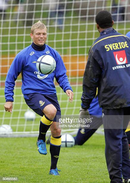 Swedish striker Marcus Allbaeck plays with the ball during the national team practice in Gimo 25 May 2004 where the preEURO 2004 camp is located some...