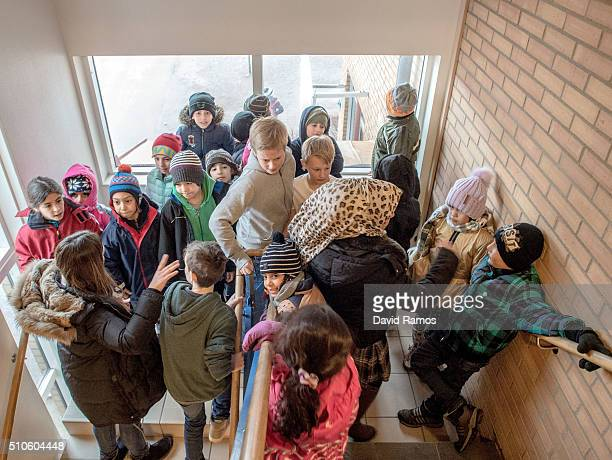Swedish students walk through a group of refugee children in a school on February 8 2016 in Halmstad Sweden Last year Sweden received 162877 asylum...