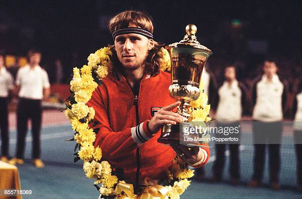 Swedish tennis player Bjorn Borg holds up the Benson Hedges Championships Trophy after defeating John Lloyd 64 64 63 in the final of the Men's...