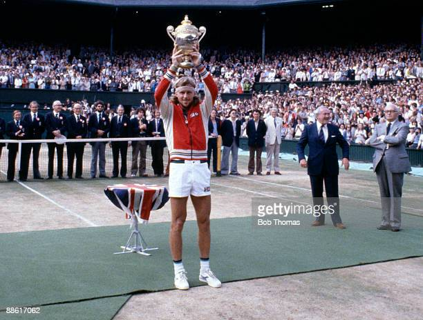 Bjorn Borg of Sweden holding the trophy after winning the men's singles title at the Wimbledon Lawn Tennis Championships held at the All England Club...