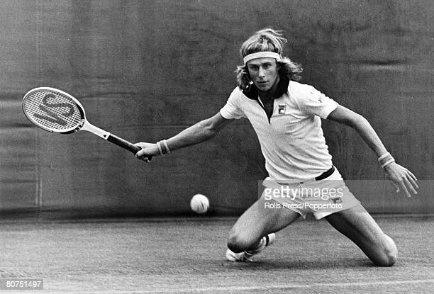 June 1975 Wimbledon Lawn Tennis Championships Sweden's Bjorn Borg the number 3 seed goes down on his knees to return a shot