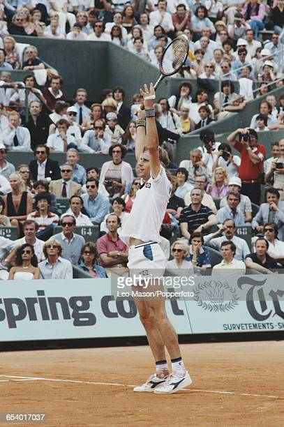 Swedish tennis player Bjorn Borg pictured raising his hands in the air in celebration after winning the final of the Men's Singles tournament to...