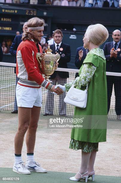Swedish tennis player Bjorn Borg pictured shaking hands with Katharine Duchess of Kent after defeating Roscoe Tanner to win the final of the Men's...