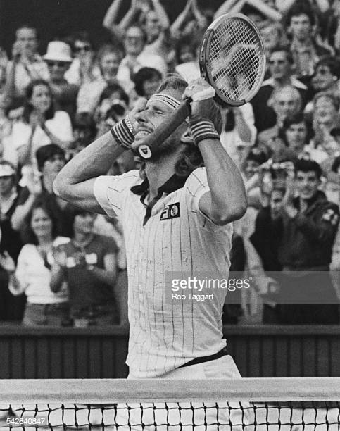 Swedish tennis player Bjorn Borg raises his arms in triumph after beating Roscoe Tanner of the USA to win his fourth successive title in the Men's...