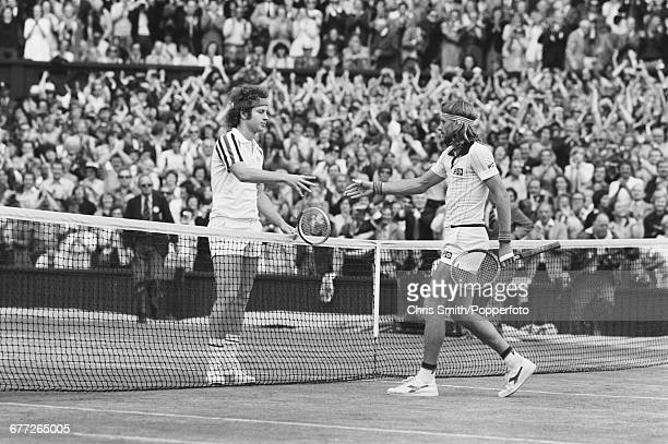 Swedish tennis player Bjorn Borg shakes hands over the net with American tennis player John McEnroe after winning the final of the Men's Singles...