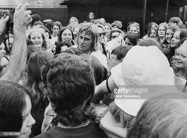 Swedish tennis player Bjorn Borg surrounded by fans at Wimbledon June 1973