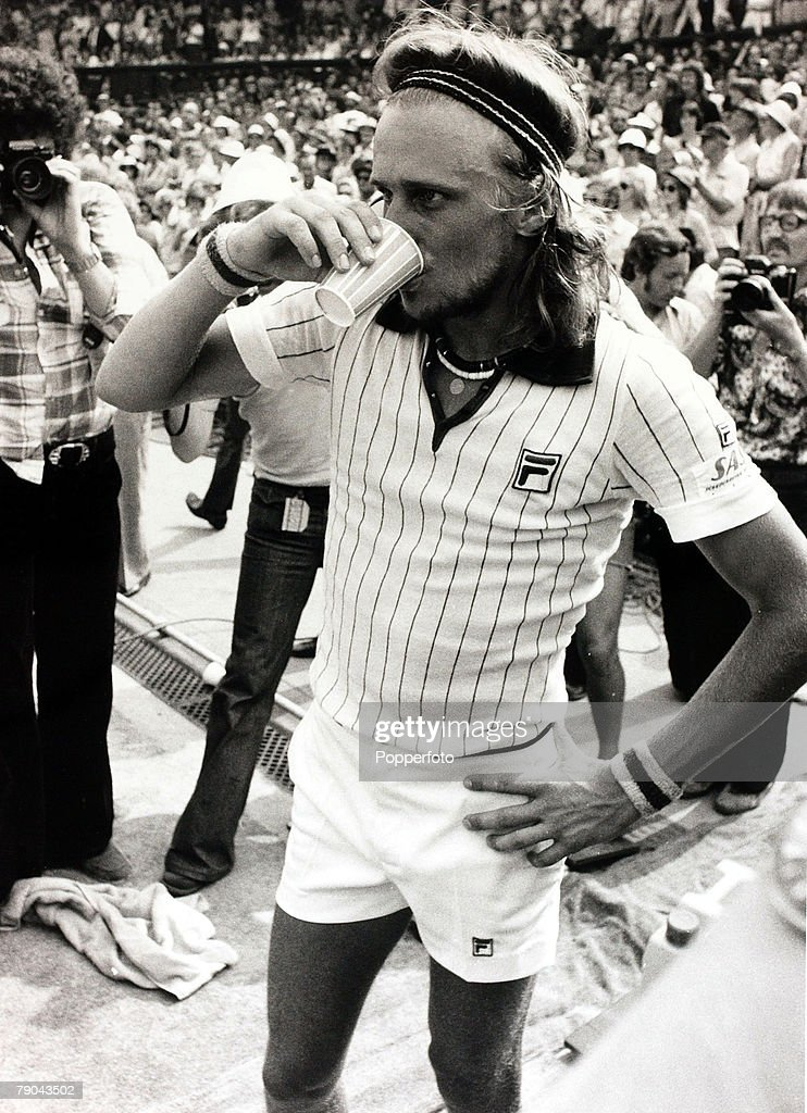 Sport, All England Lawn Tennis Championships, Wimbledon, London, England, 8th July 1976, Mens Singles Final, Sweden's Bjorn Borg takes a drink after beating Romania's Ilie Nastase to win the first of five Mens Singles Titles