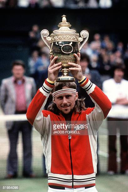 Swedish tennis player Bjrn Borg raises his fourth Wimbledon Cup won in London 07 July 1979 Born in SdertSlje Borg first major title was the Italian...
