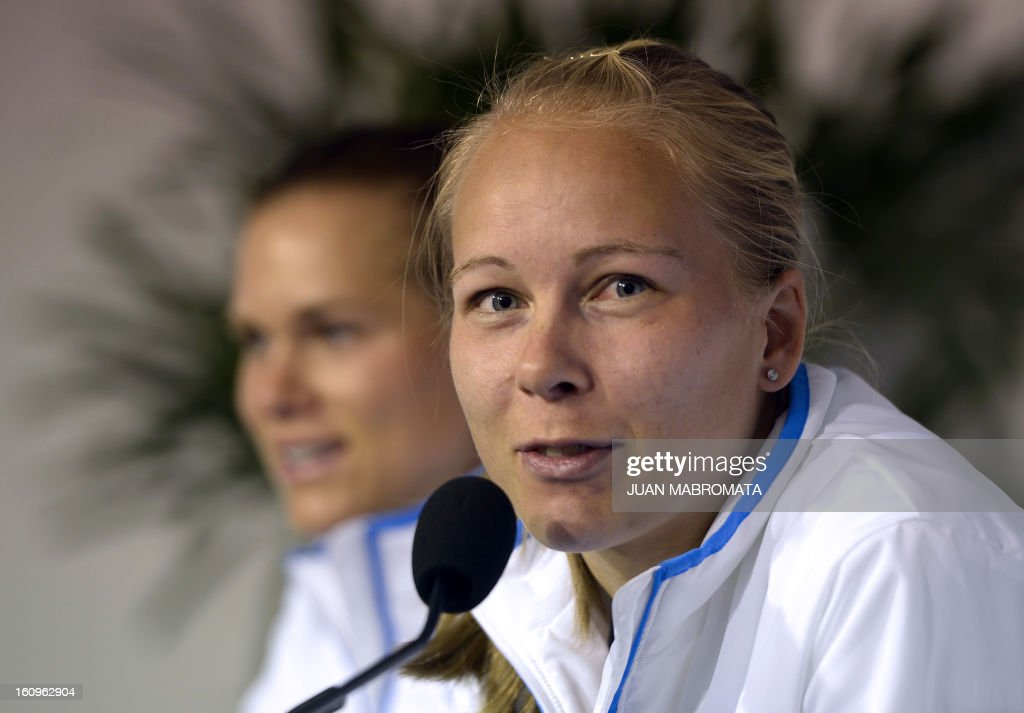 Swedish tennis player Johanna Larsson (R) answers questions during a press conference offered after the draw of the 2013 Fed Cup World Group II first round against Argentina to be held this weekend in Buenos Aires, at Parque Roca stadium in the Argentine capital, on February 8, 2012. AFP PHOTO / Juan Mabromata